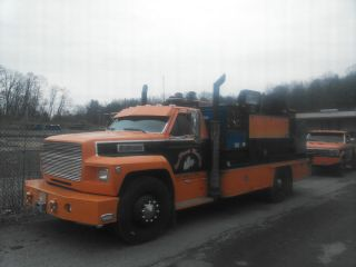 1990 Ford F 700 Service Truck with Two Miller Welders 8K Auto Crane Harley