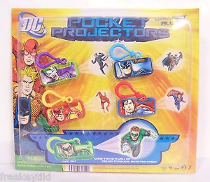 4 DC Comics Pocket Projectors Set Backpack Key Chain Clip Batman Superman Joker